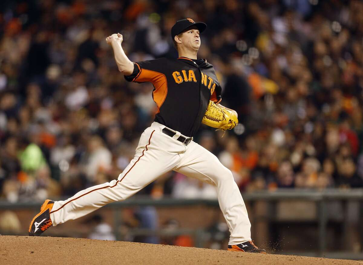 San Francisco Giants pitcher Matt Cain winds up during the fourth inning of the baseball game against the Oakland Athletics on Friday, April 3, 2015 in San Francisco, Calif.
