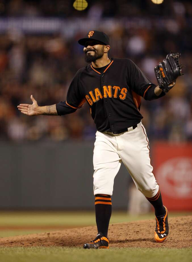 San Francisco Giants pitcher Sergio Romo reacts after defeating the Oakland Athletics on Friday, April 3, 2015 in San Francisco, Calif. Photo: Beck Diefenbach, Special To The Chronicle