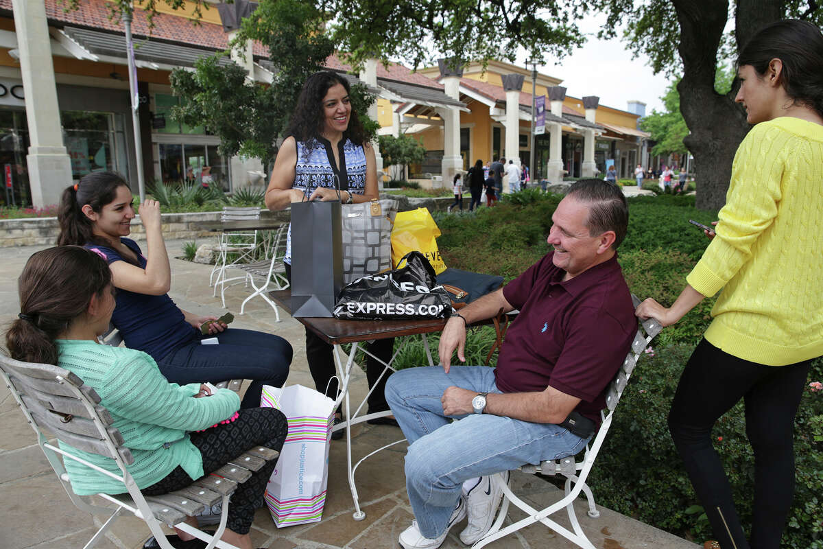 Oscar Enriquez and Dilva Orozco take a break with their children (from left) Sofia Enriquez, Karina Enriquez and Daniela Enriquez at the Shops at La Cantera during Semana Santa in San Antonio on April 2, 2015. The family traveled from the west coast of Mexico just to shop.