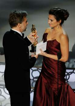 """HOLLYWOOD - MARCH 07:  Actor Christoph Waltz accepts Best Supporting Actor award for """"Inglourious Basterds"""" from presenter actress Penelope Cruz onstage during the 82nd Annual Academy Awards held at Kodak Theatre on March 7, 2010 in Hollywood, California.  (Photo by Kevin Winter/Getty Images) *** Local Caption *** Christoph Waltz;Penelope Cruz Photo: Kevin Winter, Getty Images / 2010 Getty Images"""