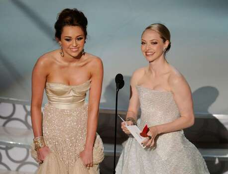HOLLYWOOD - MARCH 07:  Actresses Miley Cyrus (L) and Amanda Seyfried present onstage during the 82nd Annual Academy Awards held at Kodak Theatre on March 7, 2010 in Hollywood, California.  (Photo by Kevin Winter/Getty Images) *** Local Caption *** Miley Cyrus;Amanda Seyfried Photo: Kevin Winter, Getty Images / 2010 Getty Images