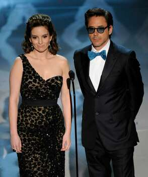 Robert Downey Jr., right, and Tina Fey present the award for original screenplay during the 82nd Academy Awards Sunday,  March 7, 2010, in the Hollywood section of Los Angeles. (AP Photo/Mark J. Terrill) Photo: Mark J. Terrill, AP / AP