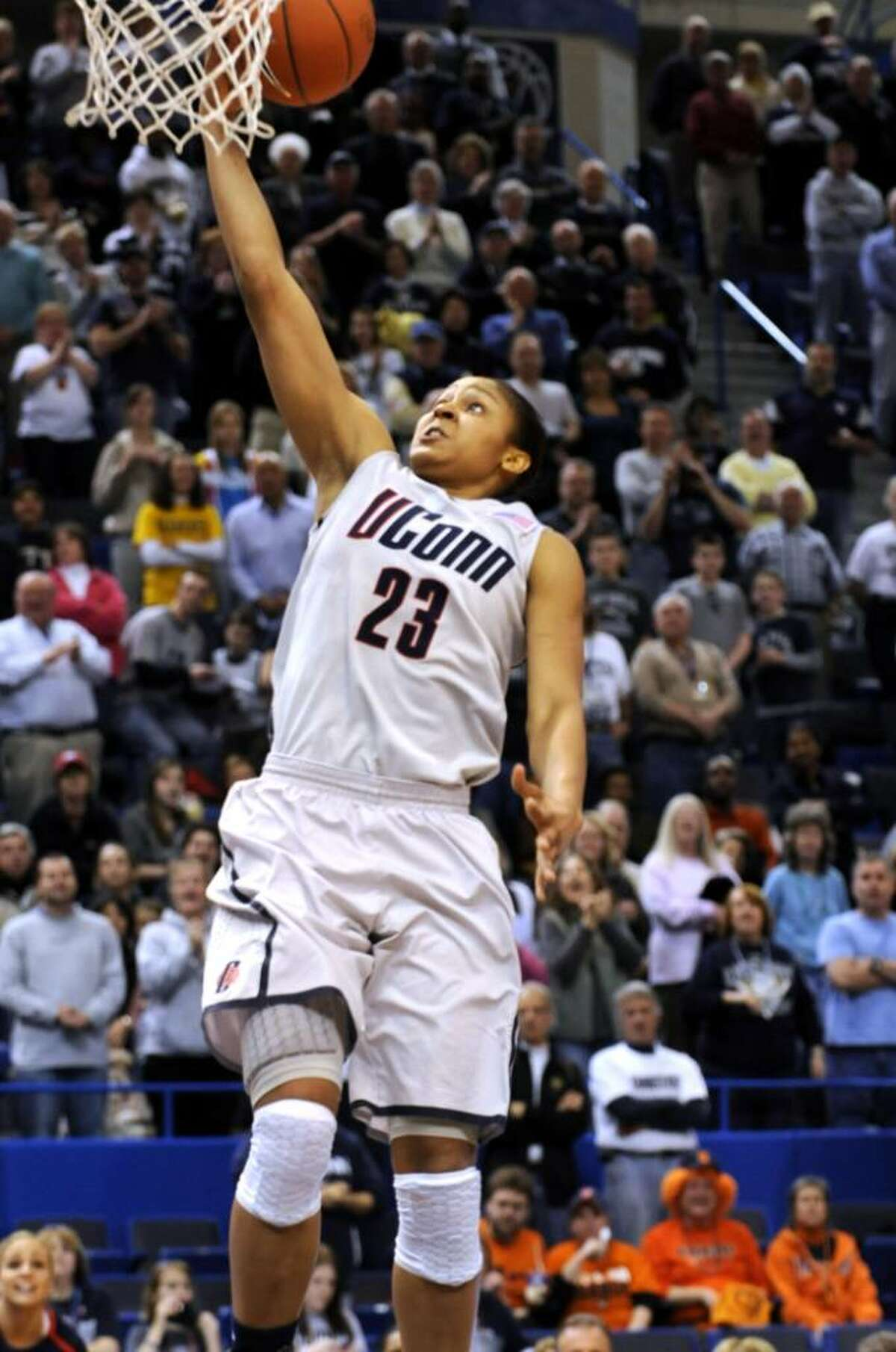 Connecticut's Maya Moore scores her 1,999th career point in the second half of an NCAA college Big East Championship quarterfinal women's basketball game against Syracuse in Hartford, Conn., Sunday, March 7, 2010. Connecticut won 77-41. (AP Photo/Bob Child)