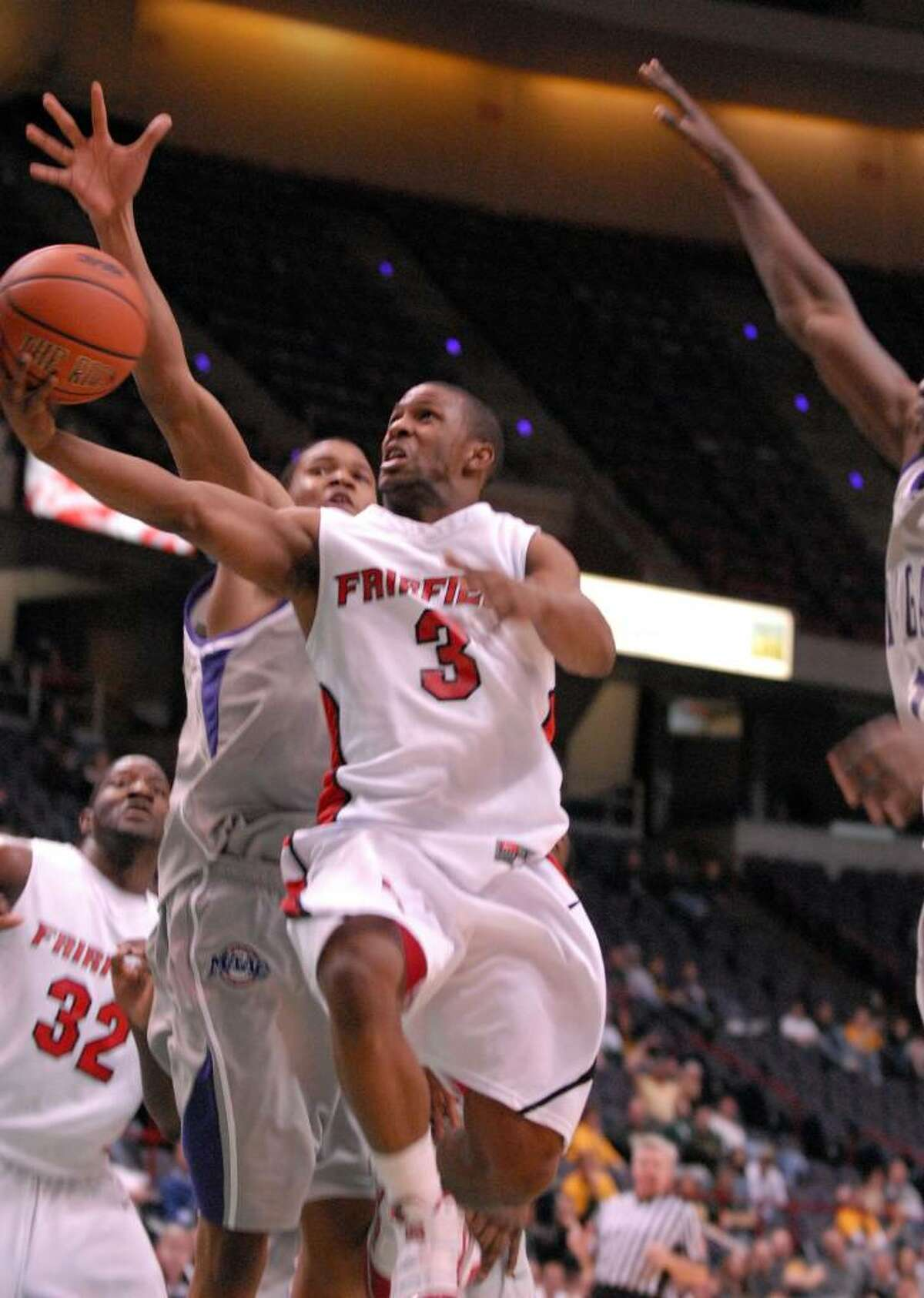 Fairfield's Derek Needham makes a lay up during the second half against Niagara, Sunday night March 7, 2010 at the Times Union Center in Albany. Fairfield beat Niagara 69 to 63 and will play in the MAAC champion game against Siena College Monday night. (Will Waldron /Times Union)