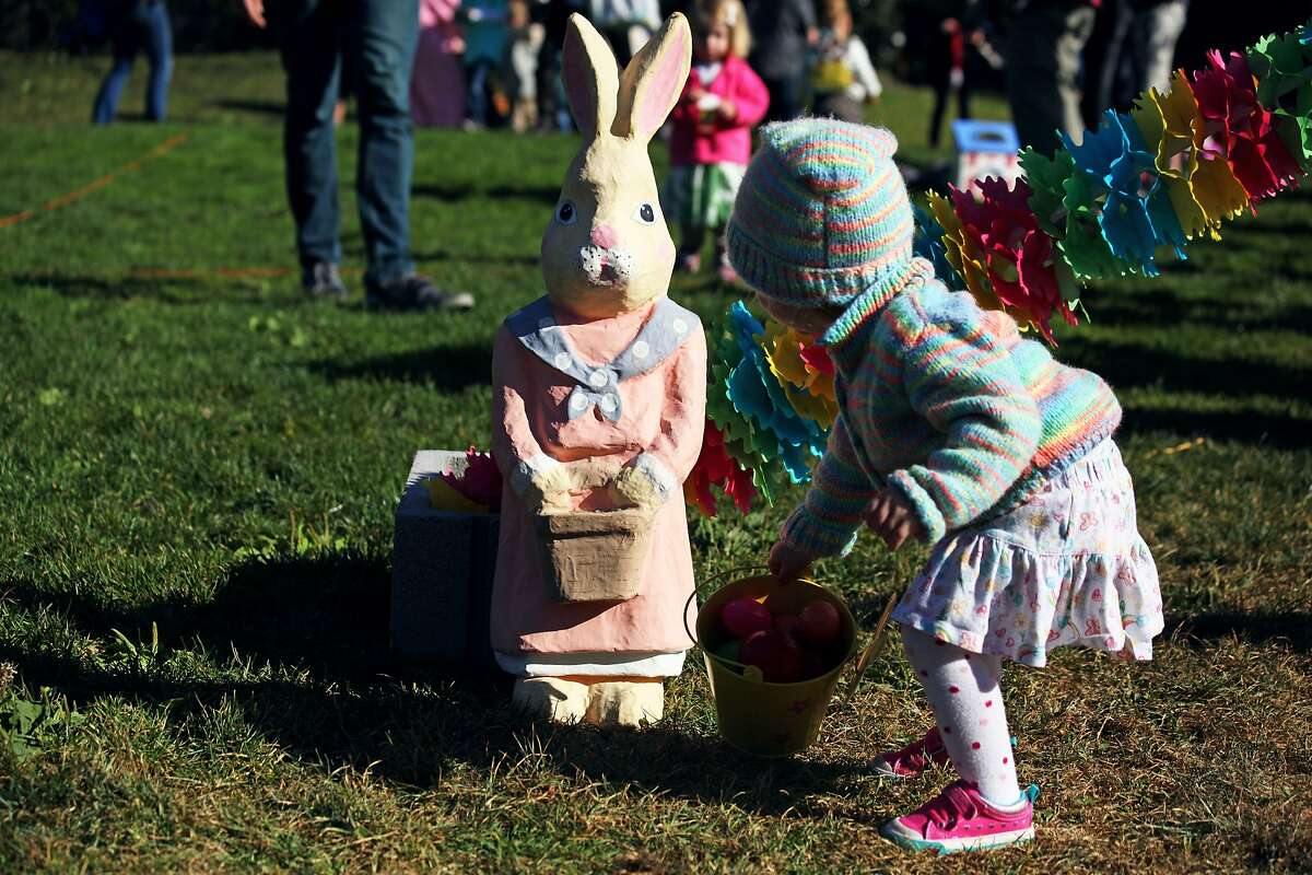 Audrey Jeter checks out bunny at the annual Easter egg hunt in Duboce Park in San Francisco, Calif., Saturday April 4, 2015.