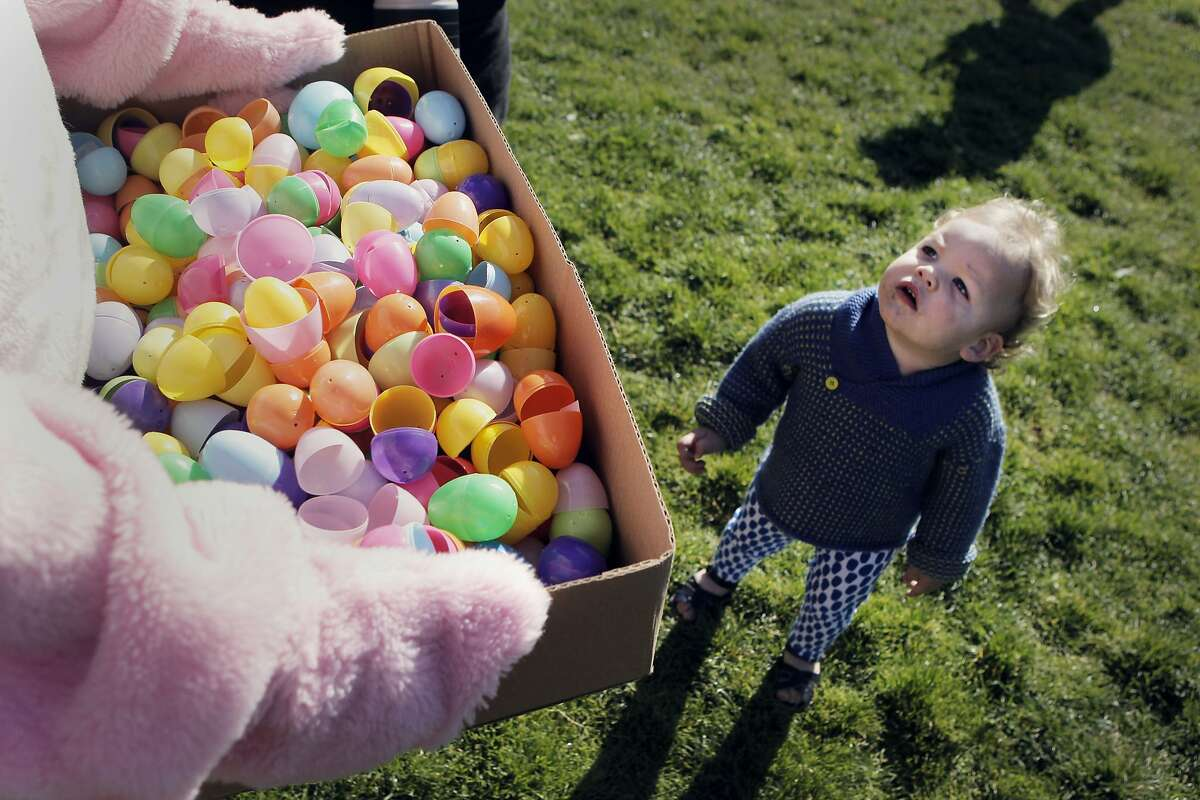 George Sidney looks up at David Strandberg AKA Easter Bunny at the annual easter egg hunt in Duboce Park in San Francisco, Calif., Saturday April 4, 2015.