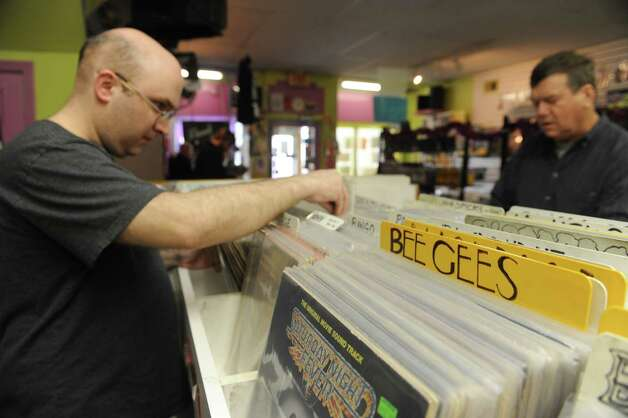Customers look through the selection of vinyl albums at Last Vestige record store on Thursday April 2, 2015 in Albany, N.Y. (Michael P. Farrell/Times Union) Photo: Michael P. Farrell / 00031296B