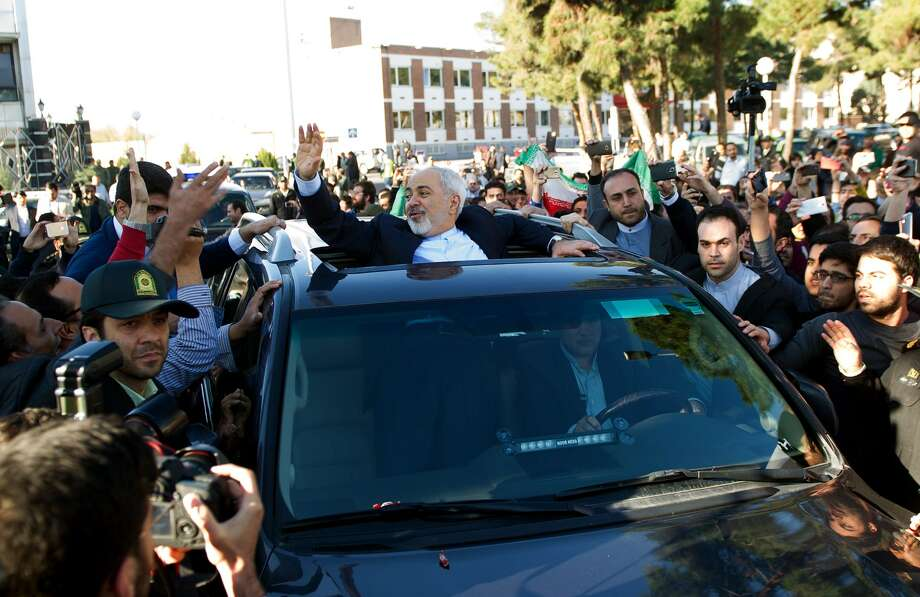 TOPSHOTS Iranian Foreign Minister Mohammad Javad Zarif (C) greets people as the nuclear negotiating committee arrive at Mehr Abad Airport in Tehran on April 3, 2015, hours after announcing they had the ingredients of a historic nuclear deal with world powers. AFP PHOTO / ISNA / BORNA GHASEMIBORNA GHASEMI/AFP/Getty Images Photo: BORNA GHASEMI / AFP / Getty Images / AFP