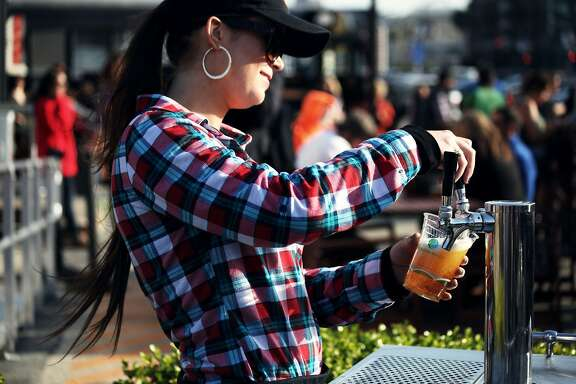 Megan Donovan serves beer at The Yard at Mission Rock next to AT&T Park in San Francisco, Calif., Friday April 3, 2015.