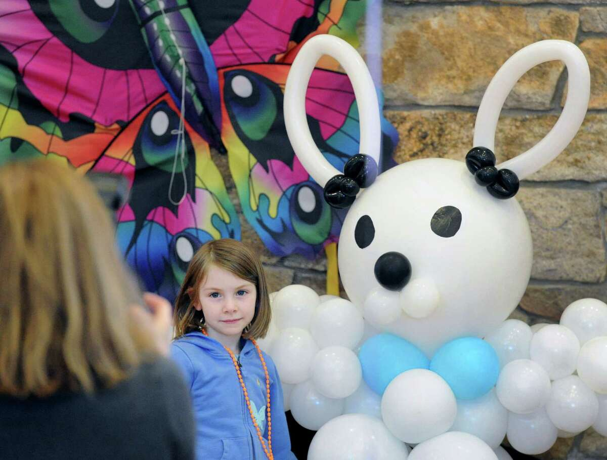 Victoria Tremblay, 5, was photographed with a balloon bunny during the Family Eggstravaganza arts & crafts activities event for Easter at the Round Hill Community House in Greenwich, Conn., Saturday, April 4, 2015.