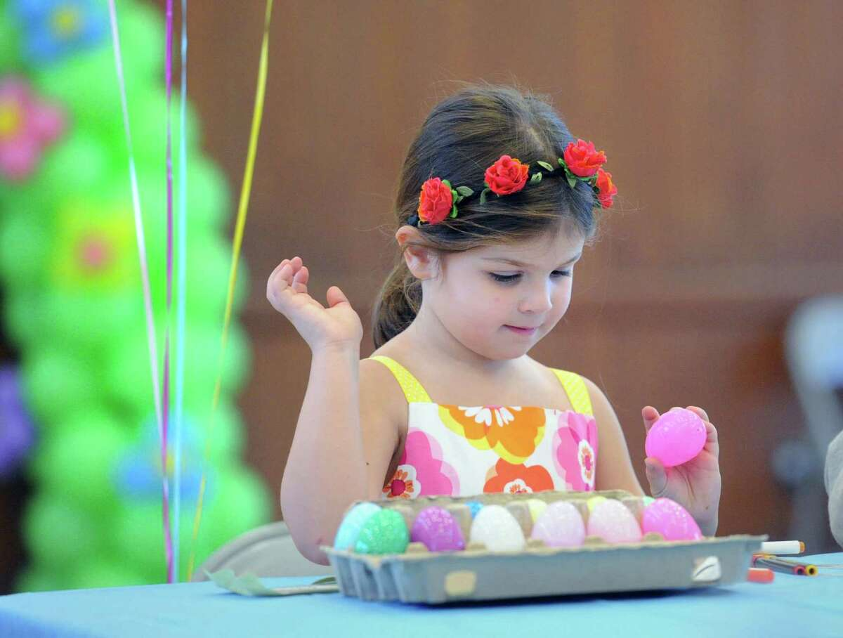 Dylan D'Antonio, 5, of Greenwich, decorates a plastic egg during the Family Eggstravaganza arts & crafts activities event for Easter at the Round Hill Community House in Greenwich, Conn., Saturday, April 4, 2015.