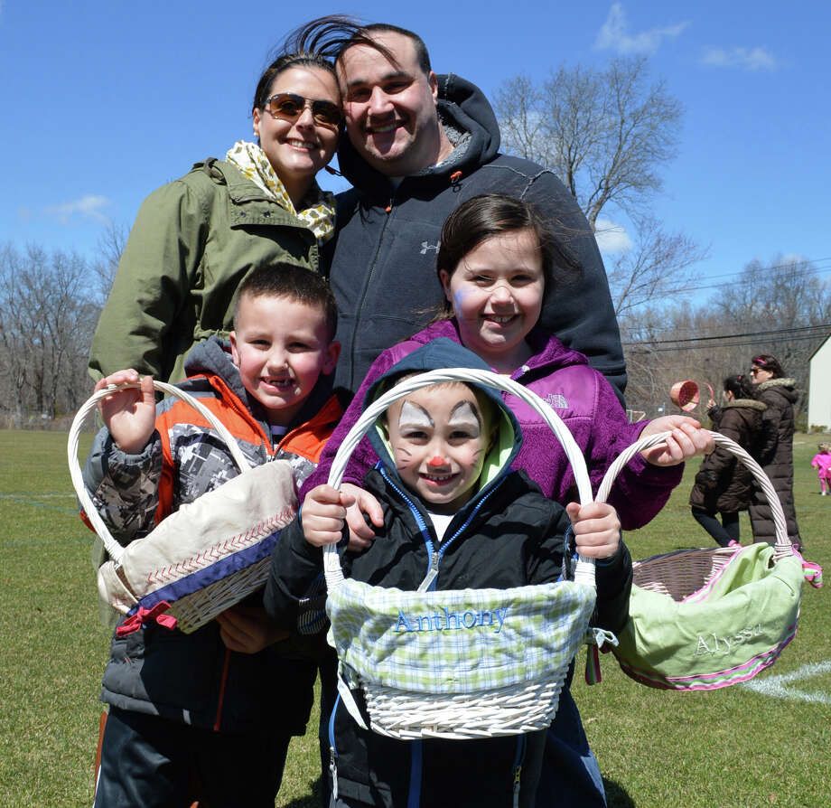 Cara Singer, now a Norwalk resident, used to hunt eggs at the Greens Farms egg hunt as a kid, but Saturday brought her family, including husband Joseph, and children, from left, Joseph Jr., 6, Anthony, 4, and Alyssa, 9. Photo: Jarret Liotta / Westport News