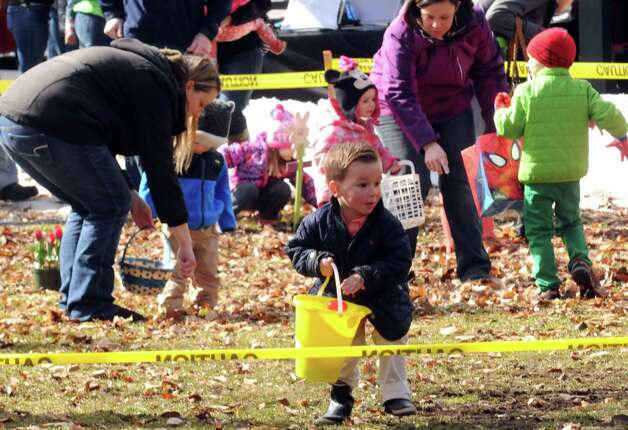 Jack O'Keefe, 3, of Saratoga Springs scramble for eggs during an Easter egg hunt as part of the EGGStravaganza at High Rock Park on Saturday April 4, 2015 in Saratoga Springs, N.Y. (Michael P. Farrell/Times Union) Photo: Michael P. Farrell / 00031295A