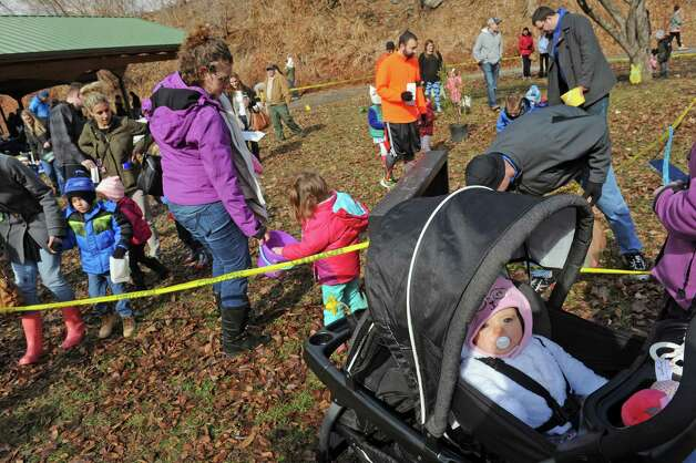 Emersyn Kreplin, 8 months, of Ballston Spa, right, stays in her stroller protected from the melee of egg gathering during an Easter egg hunt as part of the EGGStravaganza at High Rock Park on Saturday April 4, 2015 in Saratoga Springs, N.Y. (Michael P. Farrell/Times Union) Photo: Michael P. Farrell / 00031295A