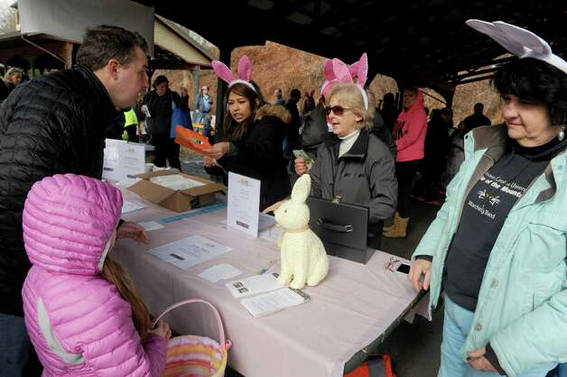 Volunteers check in participant prior to an Easter egg hunt as part of the EGGStravaganza  at High Rock Park on Saturday April 4, 2015 in Saratoga Springs, N.Y. (Michael P. Farrell/Times Union) Photo: Michael P. Farrell / 00031295A