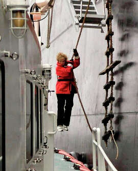 Nancy Wagner descends from a ship at sea to a pilot boat by using what sailors call a Jacob's ladder. Wagner was the first female ship pilot in the U.S.