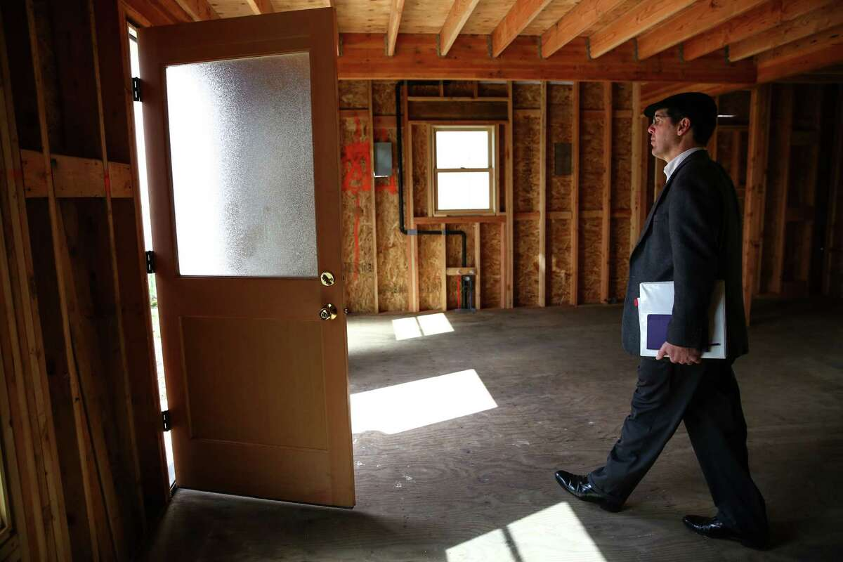 Realtor Paul Thomas walks to the front door in the former home of Edith Macefield as the house goes up for sale on Tuesday, March 31, 2015 in Seattle's Ballard neighborhood.