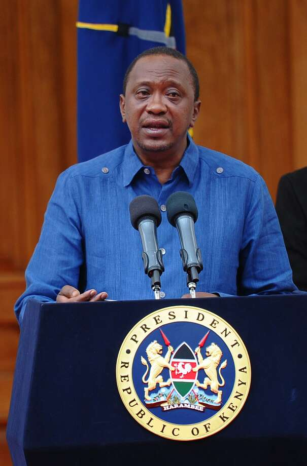 """Kenyan President Uhuru Kenyatta addresses the Nation at the State House capital Nairobi on April 4, 2015 where he declared 3 days of national mourning following the Garissa University College terror attack and promised to support the victims. Kenyatta on Saturday warned Somalia's Al-Qaeda-linked Shebab fighters his government will respond to their killing of almost 150 students in the """"severest way"""" possible. AFP PPHOTO / JOHN MUCHUCHAJohn Muchucha/AFP/Getty Images Photo: JOHN MUCHUCHA, Stringer / AFP"""