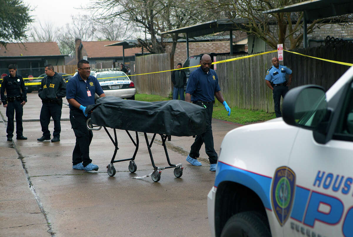 The Houston Police Department works a scene after a father and his teenage daughter were found fatally shot on the city's north side in March.