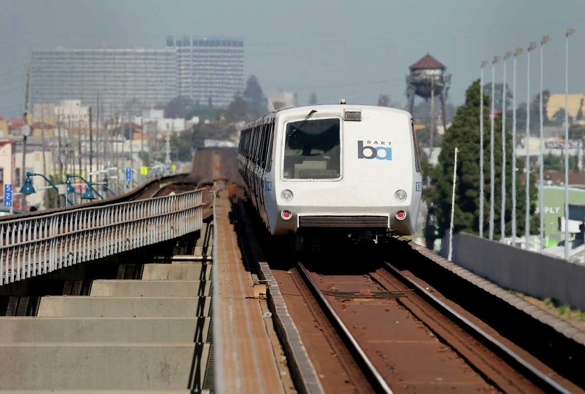 a southbound BART train approaches the Coliseum station having just crossed over a part of the track and wooden ties that will be replaced soon Wednesday March 18, 2015. BART officials announced a major track repair project between the Fruitvale and Coliseum stations beginning in early April.