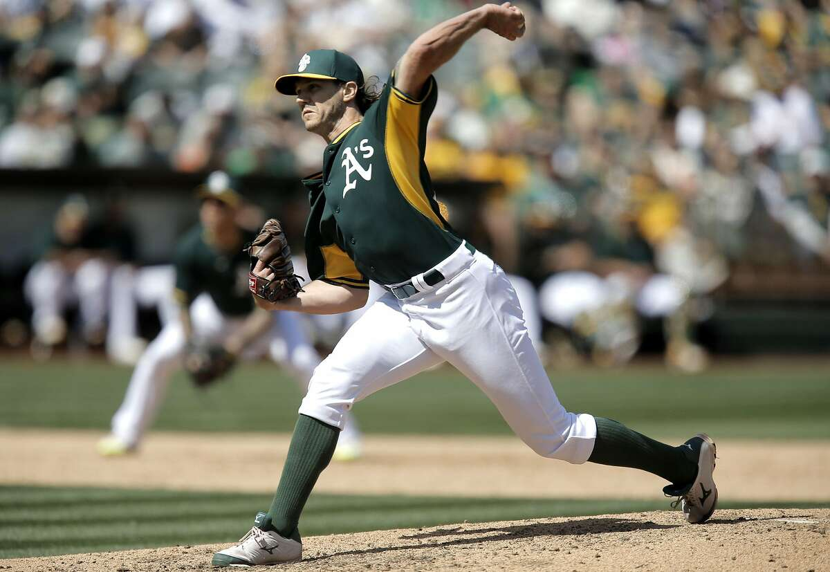 A's pitcher Barry Zito, throws in the 6th inning as the Oakland Athletics went on to lose to the San Francisco Giants 2-1 in game three of the Bay Bridge Series at O.co Coliseum in Oakland, Calif., as seen on Sat.. April 4, 2015.