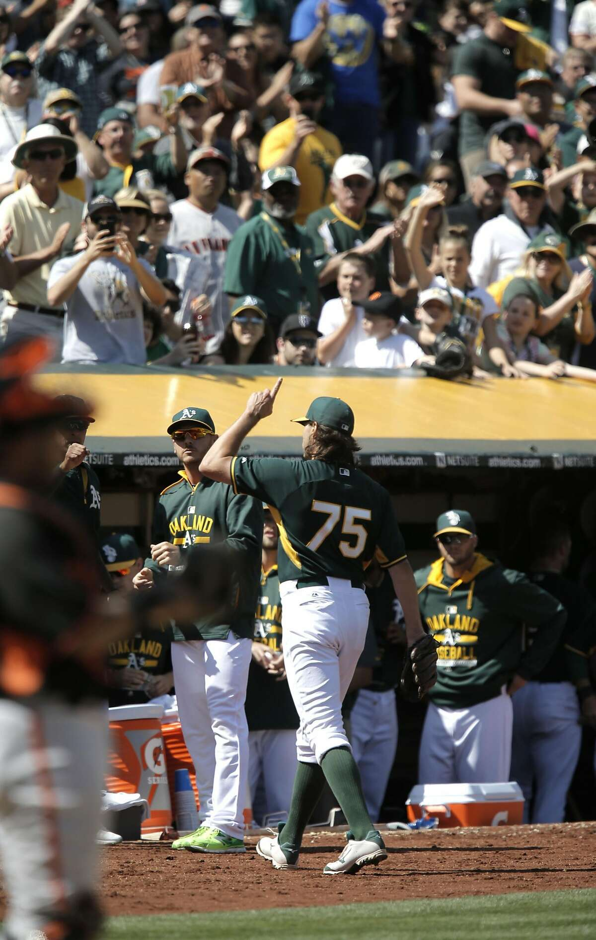 A's pitcher Barry Zito, leaves in the 6th inning to a standing ovation from the crowd, as the Oakland Athletics went on to lose to the San Francisco Giants 2-1 in game three of the Bay Bridge Series at O.co Coliseum in Oakland, Calif., as seen on Sat.. April 4, 2015.