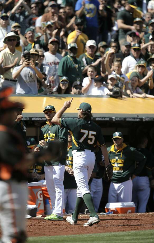 A's pitcher Barry Zito, leaves in the 6th inning to a standing ovation from the crowd, as the Oakland Athletics went on to lose to the  San Francisco Giants 2-1 in game three of the Bay Bridge Series at O.co Coliseum in Oakland, Calif., as seen on Sat.. April 4, 2015. Photo: Michael Macor, The Chronicle