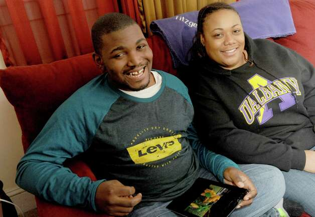Neketa Roberts and her 22-year-old son, Elijah Roberts, who suffers from mental health issues and developmental disabilities, has been threatened in the past by police who said they were going to Taser him when he got agitated,at there home on Saturday April 4, 2015 in Saratoga Springs, N.Y. (Michael P. Farrell/Times Union) Photo: Michael P. Farrell / 00031317A
