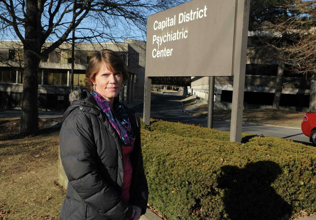 Heidi DiTonno stands outside the Capital District Psychiatric Center where she used to work on Tuesday, March 24, 2015 in Albany, N.Y. DiTonno recently learned the boss who sexually harassed her years ago had landed the job of Saratoga County mental health director. (Lori Van Buren / Times Union)
