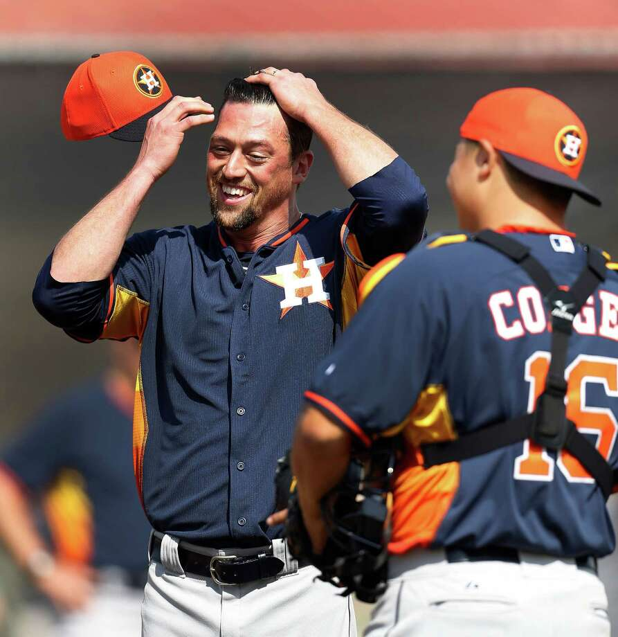 Luke Gregerson, joking with catcher Hank Conger in spring training, wants to bring more smiles to the mound for the Astros as the team's new closer after strong seasons in San Diego and Oakland. Photo: Karen Warren, Staff / © 2015 Houston Chronicle