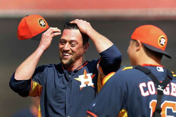 Luke Gregerson, joking with catcher Hank Conger in spring training, wants to bring more smiles to the mound for the Astros as the team's new closer after strong seasons in San Diego and Oakland.