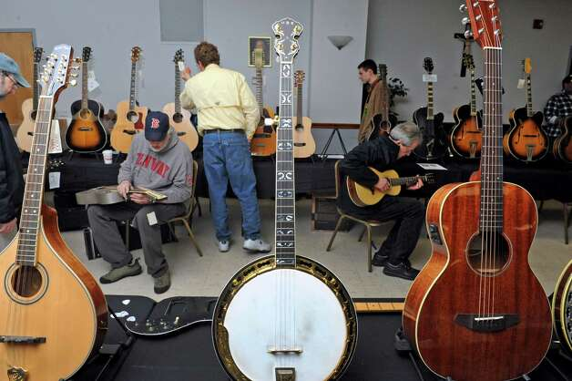 String instrument enthusiasts attend the Capital Region Guitar Show at the Knights of Columbus Hall on Saturday April 4, 2015 in Saratoga Springs, N.Y. (Michael P. Farrell/Times Union) Photo: Michael P. Farrell / 00031302A