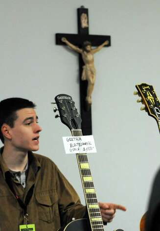 Sales representative Drew Vanderhorn of Saratoga Guitar talks with a customer during the Capital Region Guitar Show at the Knights of Columbus Hall on Saturday April 4, 2015 in Saratoga Springs, N.Y. (Michael P. Farrell/Times Union) Photo: Michael P. Farrell / 00031302A