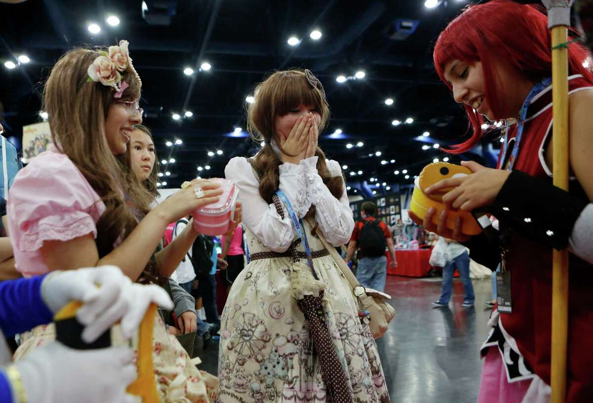 Jennifer, Kalina Hieshima and Lorena Garcia exchange gifts at the ninth annual Anime Matsuri convention, one of the most popular in the country, at George R. Brown Convention Center on Saturday in Houston.