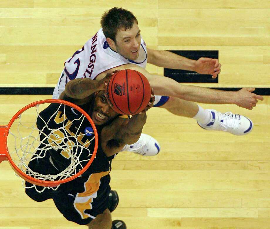 FOR SPORTS - VCU's Jamie Skeen goes up for a dunk around Kansas' Brady Morningstar during second half action of the NCAA Southwest Regional Final Sunday March 27, 2011 at the Alamodome. VCU won 71-61. (PHOTO BY EDWARD A. ORNELAS/eaornelas@express-news.net) Photo: EDWARD A. ORNELAS, Eaornelas@express-news.net / SAN ANTONIO EXPRESS-NEWS / SAN ANTONIO EXPRESS-NEWS NFS