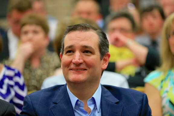 Presidential candidate Sen. Ted Cruz, R-Texas, sits in the front row as he waits to be introduced at a town hall event at Morningside College in Sioux City, Iowa, Wednesday, April 1, 2015. (AP Photo/Nati Harnik)