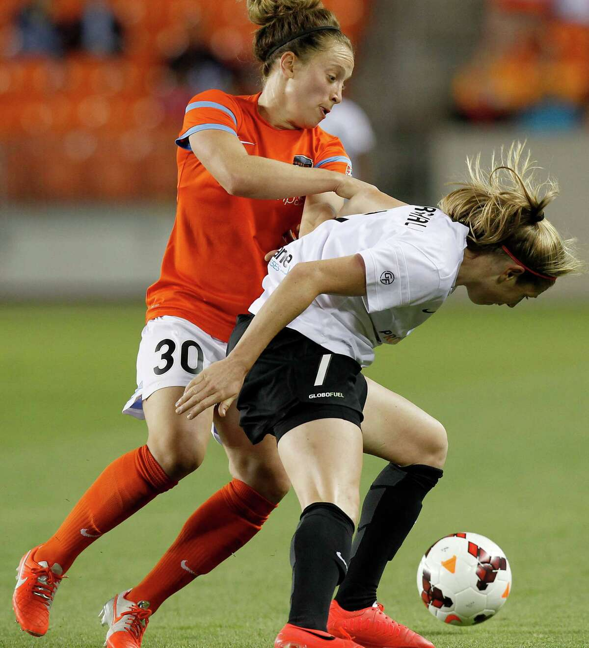Houston Dash Ella Masar (30 has trouble going around Portland Thorns Nikkin Marshall (7) in the second half on May 14, 2014 at BBVA Compass Stadium in Houston, TX. Portland won 1 to 0. (Photo: Thomas B. Shea/For the Chronicle)
