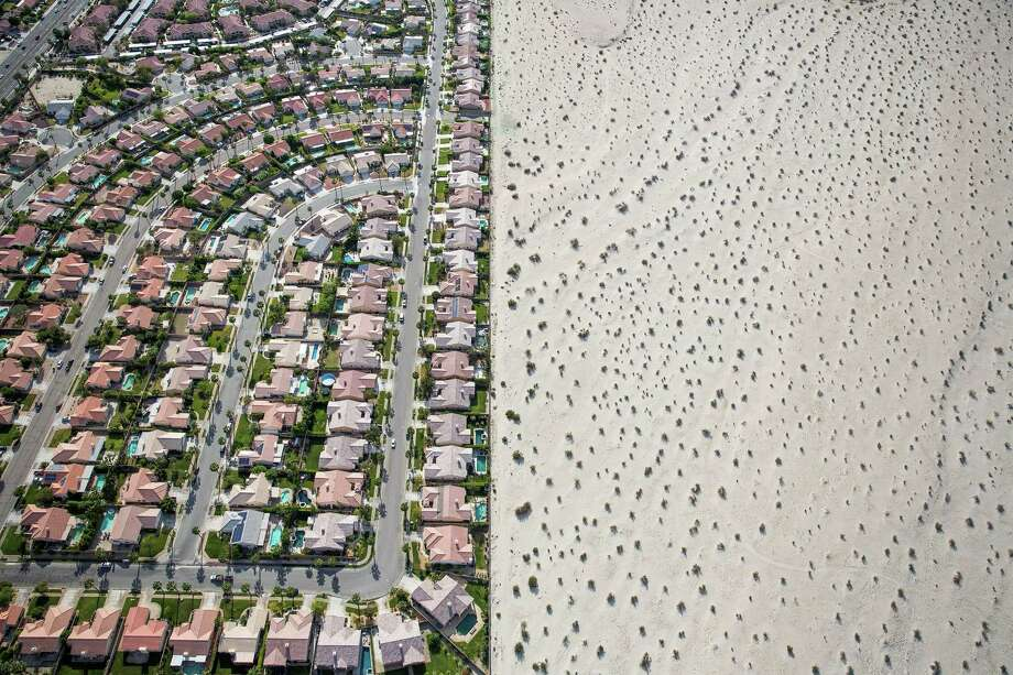 A housing development sits on the edge of undeveloped desert in Cathedral City, Calif. The state's history as a frontier of prosperity and glamour faces an uncertain future as the fourth year of severe water shortages has prompted Gov. Jerry Brown to mandate a 25 percent reduction in non-agricultural water use. Photo: DAMON WINTER, STF / NYTNS