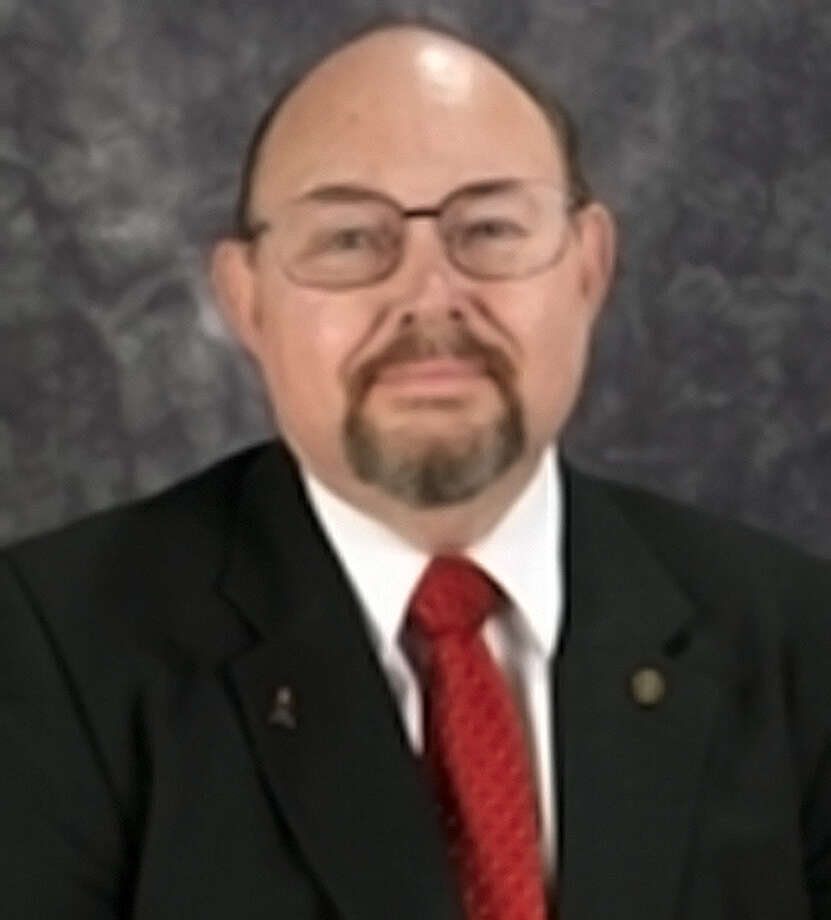 Retired teacher George Lynn Britton Jr. has served three terms on Northside  ISD's board. Photo: /