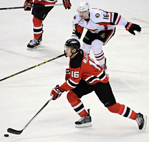 Albany Devils' #16 Chris McKelvie, and Binghamton Senators' #16 Garrett Thompson, top, during Saturday's game at the Times Union Center April 4, 2015 in Albany, NY.  (John Carl D'Annibale / Times Union) Photo: John Carl D'Annibale / 00030124R