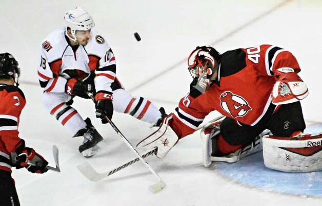 Binghamton Senators' #18 Shane Prince fails to score against Albany Devils' goalie Scot Clemmensen, right, during Saturday's game at the Times Union Center April 4, 2015 in Albany, NY.  (John Carl D'Annibale / Times Union) Photo: John Carl D'Annibale / 00030124R