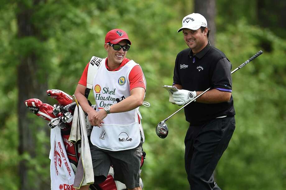 Patrick Reed and his caddie Kessler Karain walk to the 13th tee Saturday at the Shell Houston Open. The two later had a race to the 17th tee box, with the caddie, Reed's brother-in-law, winning handily. Photo: Stacy Revere, Stringer / 2015 Getty Images