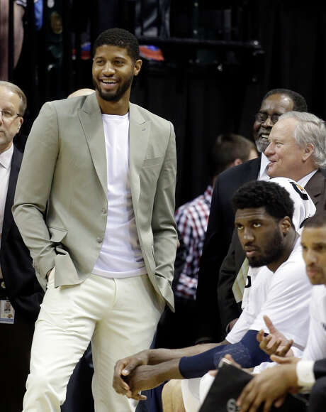 FILE - In this March 10, 2015, file photo, Indiana Pacers' Paul George, left, watches during the second half of an NBA basketball game against the Orlando Magic in Indianapolis. George will play Sunday, April 5, 2015, against the Miami Heat, just eight months after he broke his right leg while playing for Team USA in an exhibition game in Las Vegas, the team announced, Saturday, April 4. (AP Photo/Darron Cummings, File) Photo: Darron Cummings, STF / AP