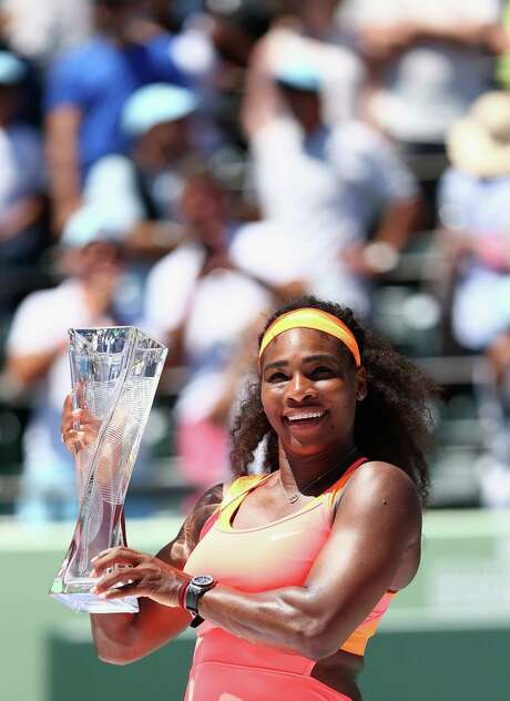 Serena Williams holds aloft the Butch Buchholz Trophy after winning the Miami Open on Saturday. Photo: Clive Brunskill, Staff / 2015 Getty Images