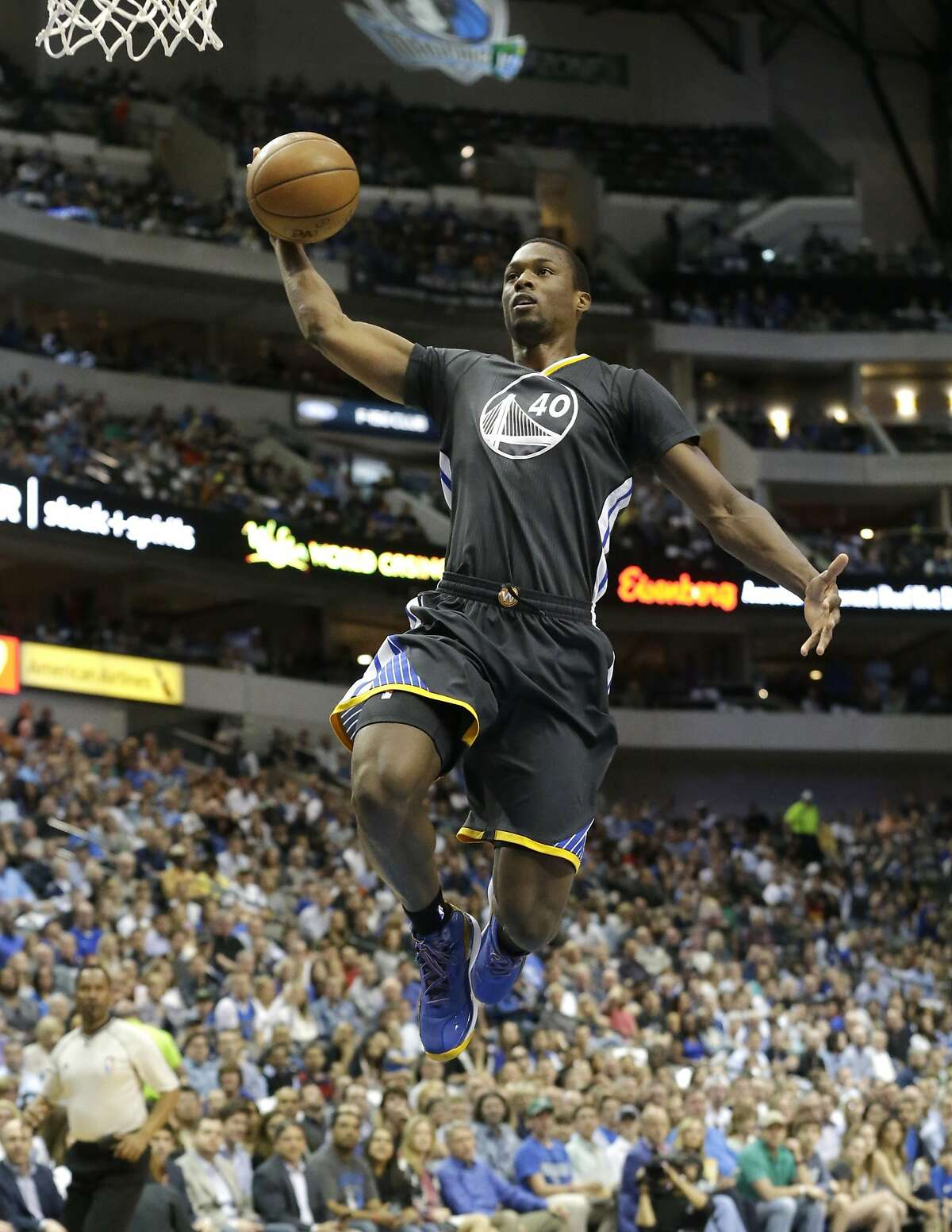 Golden State Warriors forward Harrison Barnes slam dunks during the first half of an NBA basketball game against the Dallas Mavericks Saturday, April 4, 2015, in Dallas. (AP Photo/LM Otero)