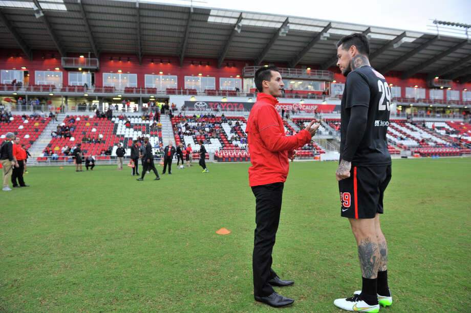 Scorpions coach Alen Marcina talks with player Eric Hassli before the 2015 spring season opener against the Tampa Bay Rowdies. Photo: Robin Jerstad /For The Express-News