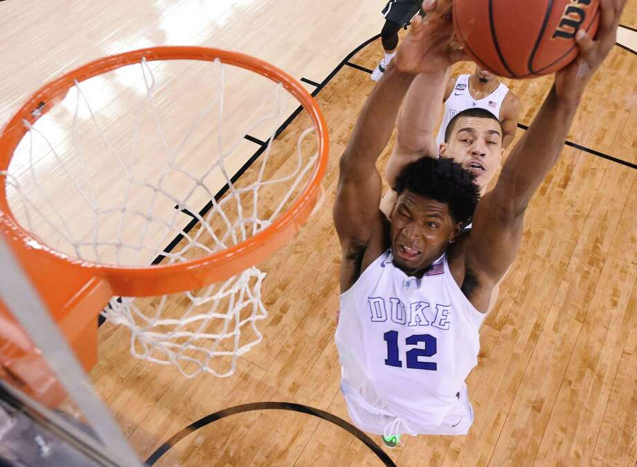 Duke's Justise Winslow, left, was too much to handle for Gavin Schilling and his Michigan State teammates, finishing with 19 points. Photo: Chris Steppig, Pool / NCAA Photos