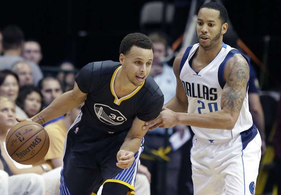 Golden State Warriors guard Stephen Curry (30) drives against Dallas Mavericks guard Devin Harris (20) during the second half of an NBA basketball game, Saturday, April 4, 2015, in Dallas. The Warriors won 123-110. (AP Photo/LM Otero) Photo: LM Otero, Associated Press