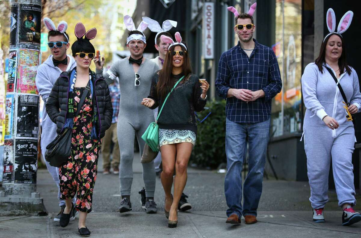 Participants march from Capitol Hill during BunnyCon. The annual springtime bar hop celebrates the season with some fun, creativity and a few raised glasses. Photographed on Friday, April 3, 2015.
