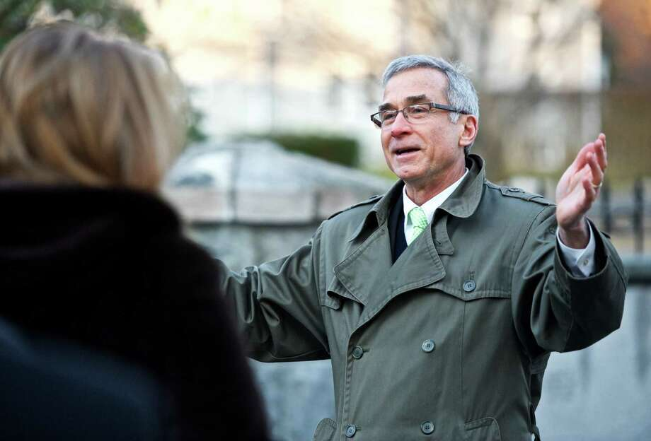 Pastor Charles Hambrick-Stowe, Senior Minister of the First Congregational Church of Ridgefield, leads their Easter sunrise service on Sunday, April 5, 2015, in Ridgefield, Conn. The service took place in the courtyard garden of the church. Photo: H John Voorhees III / The News-Times